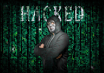 Hacker with arms crossed behind a mask in matrix style