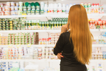 Beautiful woman shopping at the groceries store