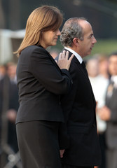 Mexican President Calderon and his wife Zavala walk together after funeral ceremony of Mexico's Interior Minister Blake and seven other victims of helicopter crash, in Mexico City