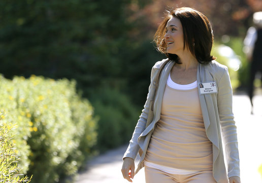 Sheryl Sandberg, COO of Facebook, wearing someone else's ID badge, arrives for the third day of the Allen and Co. media conference in Sun Valley