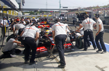 McLaren Formula One driver Hamilton of Britain practices a pit stop during the second practice session for the Hungarian F1 Grand Prix at the Hungaroring circuit near Budapest