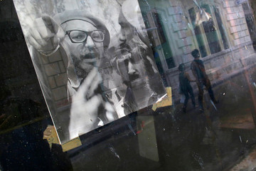 A picture of Fidel Castro is seen on the window of a local shop, following the announcement of the death of the Cuban revolutionary leader, in Havana, Cuba