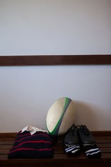 Rugby ball with clothes and shoes