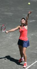 Caroline Wozniacki of Denmark delivers her serve to Barbora Zahlavova Strycova of Czech Republic in Charleston