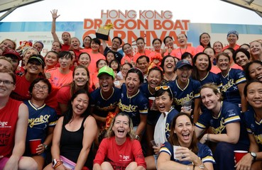 The winners of the Quality Tourism Services Association International Women's Grand Championship pose for a picture after the prize presentation. Hong Kong celebrates the Dragon Boat Festival with three days of races and parties as part of the 40th anniver