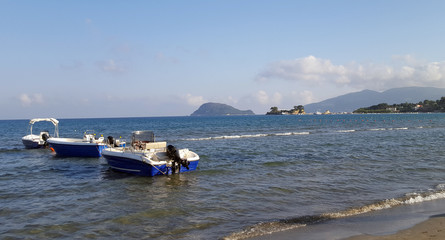 Boats in the Laganas Bay with the Marathonisi Island and Cameo island