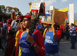 Supporters of the late Venezuelan President Hugo Chavez arrive at the Military Academy where his wake will be held, in Caracas