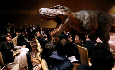 Japan's On-Art Corp's eight metre tall dinosaur-shaped mechanical suit robot 'TRX03' performs during its unveiling in Tokyo