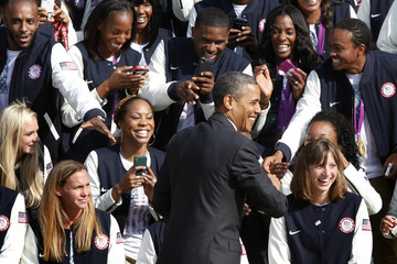 U.S. President Obama smiles as he greets members of the 2012 U.S. Olympic and Paralympic teams during a reception at the White House in Washington