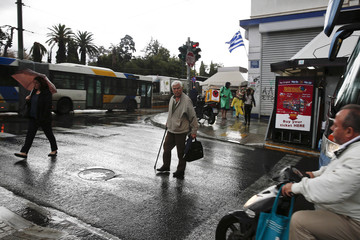 Man crosses a main street in Athens