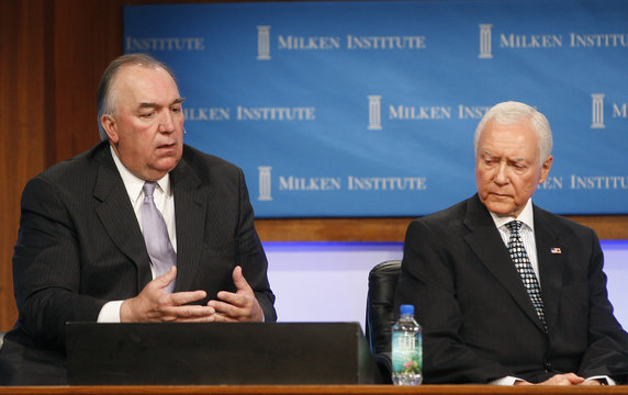 John Engler (L), president of the Business Roundtable, speaks as U.S. Senator Orrin Hatch, ranking member of the Senate Committee on Finance, listens at the 2011 The Milken Institute Global Conference in Beverly Hills