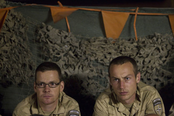 Dutch soldiers react during a screening of the 2010 World Cup soccer match final between Spain and the Netherlands, at a military camp in Kabul