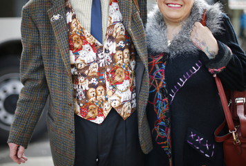 A man wearing a dog print waistcoat arrives for the first day of the Crufts Dog Show in Birmingham