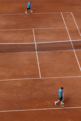 Workers clean the court lines during the French Open tennis tournament at the Roland Garros stadium in Paris