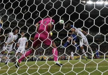 Italy's De Rossi heads to score a goal during their Confederations Cup Group A soccer match against Japan at the Arena Pernambuco in Recife