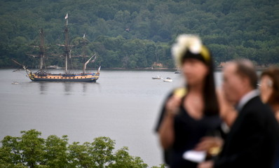 A replica of the French navy frigate L'Hermione is seen as guests drink wine prior to the gala dinner in the honor of the L'Hermione at Mount Vernon, Virginia