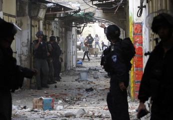 Palestinians throw stones at Israeli police and border police during clashes in Jerusalem's Old City