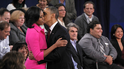U.S. President Obama hugs his wife Michelle at the conclusion of his debate against Republican presidential nominee Romney in the second U.S. presidential debate in Hempstead