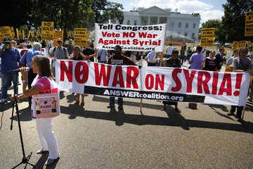 Code Pink co-founder Benjamin leads a rally against proposed U.S. military action in Syria, in front of the White House in Washington