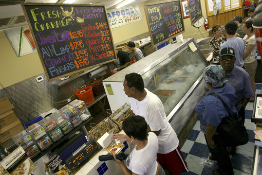 Customers stand in line at Deanie's Seafood in Metairie
