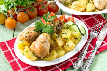 Chicken drumsticks, baked with potatoes