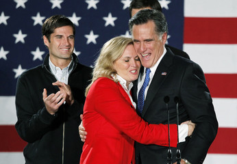 Republican presidential candidate and former Massachusetts Governor Mitt Romney hugs his wife Ann as he appeared at his Iowa Caucus night rally in Des Moines