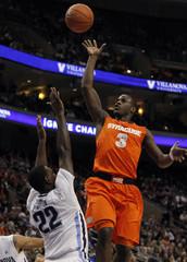 Syracuse guard Waiters shoots over the defense of Villanova forward Pinkston during their NCAA basketball game in Philadelphia