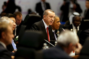 Erdogan delivers opening remarks at in a working session on the global economy with fellow world leaders at the start of the G20 summit at the Regnum Carya Resort in Antalya, Turkey