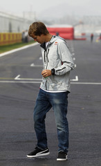 Red Bull Formula One driver Sebastian Vettel of Germany checks the surface of the track at the Korea International Circuit in Yeongam