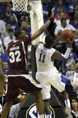 Mississippi State forward Jarvis Varnado blocks Kentucky guard John Wall way to the basket during the championship game of the NCAA men's Southeastern Conference basketball championship in Nashville, Tennessee