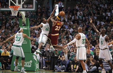 Cleveland Cavaliers' LeBron James is challenged by Boston Celtics' Perkins in Game 4 of their NBA playoff basketball series in Boston