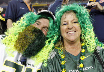 Oregon Ducks fans show their team spirit before the NCAA BCS National Championship college football game against the Auburn Tigers in Glendale, Arizona