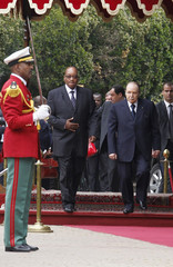Algerian President Bouteflika and South Africa President Zuma review honour guard during welcoming ceremony at the Presidential Palace in Algiers
