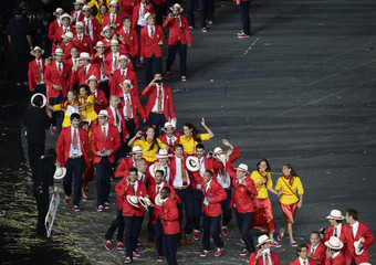 Members of Spain's contingent participate in the athletes parade during the opening ceremony of the London 2012 Olympic Games at the Olympic Stadium