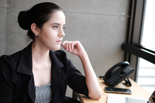 Portrait of introspective businesswoman in the office