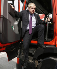 """London Mayor Boris Johnson exits the cabin of a truck during an """"Out"""" campaign event, in favour of Britain leaving the European Union, at Europa Worldwide freight company in Dartford"""