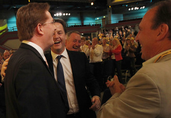 Britain's deputy prime minister Clegg congratulates the Chief Secretary to the Treasury Alexander after his speech during the Liberal Democrats annual autumn conference in Birmingham
