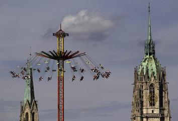 Revellers enjoy a ride in a roller coaster after the opening of the World's biggest beer fest, the Munich Oktoberfest, at the Theresienwiese in Munich