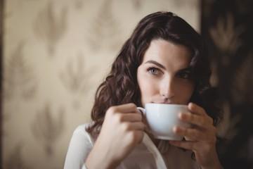 Thoughtful woman having coffee