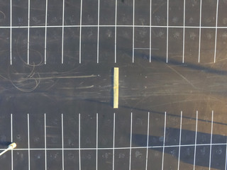 Aerial view of an empty parking lot in Houston, Texas, USA. Plenty of parking space.