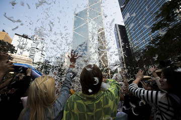 People take part in the International Pillow Fight Day at Hong Kong's financial Central district