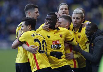 Watford's M'Baye Niang celebrates scoring their second goal with teammates