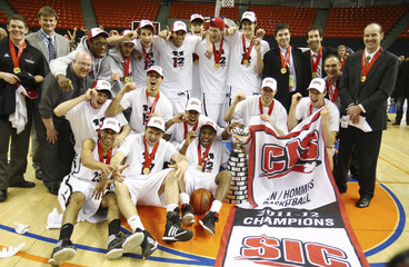 Carleton Ravens' basketball team pose for team photo following CIS championship final at Metro Centre in Halifax
