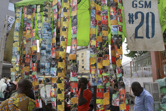 Used mobile telephone cards are stringed together at a roadside call centre in the district of Obalende in Nigeria's commercial capital Lagos