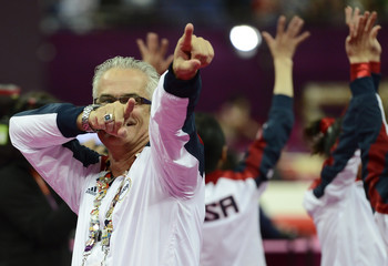 U.S. gymnastics coach  John Geddert celebrates during the women's gymnastics team final at the London 2012 Olympic Games