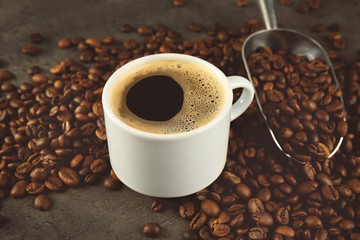 Cup of coffee and scoop on beans