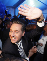 Austria's far-right Freedom Party leader Strache waves as he celebrates after provincial elections in Vienna