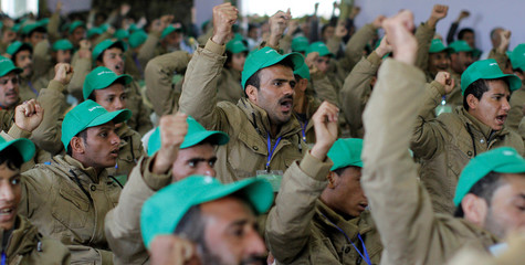 Pro-Houthi fighters, who have been injured during recent fighting, shout slogans during a rally held to honour those injured or maimed while fighting in Houthi ranks in Sanaa, Yemen