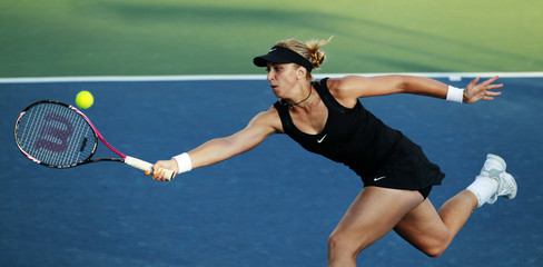 Germany's Lisicki returns the ball against Williams of the U.S. during her Stanford Classic semi-final tennis match in Stanford