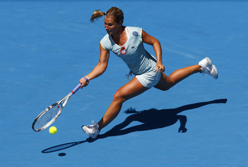 Cibulkova of Slovakia hits a return to Wozniacki of Denmark during their match at the Australian Open tennis tournament in Melbourne